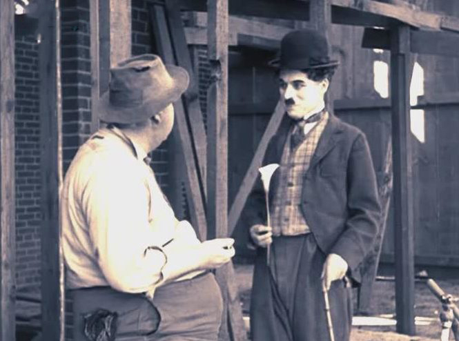 За зарплатойИзображение: Цитата из х∕ф «День получки». Реж. Чарли Чаплин. 1922. США